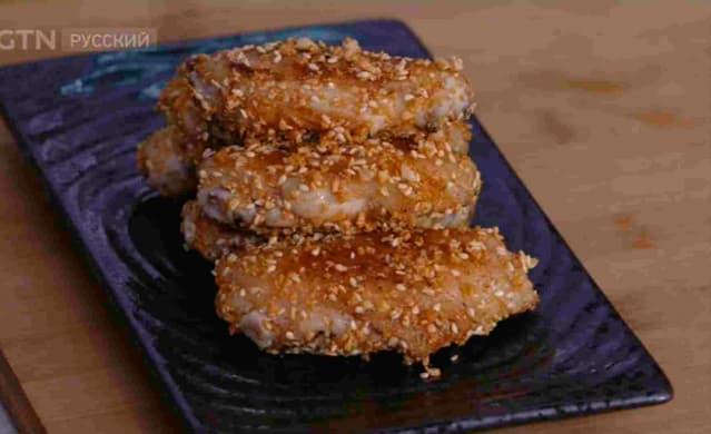 Фотография китайского блюда «Куриные крылышки с чесночным ароматом»
